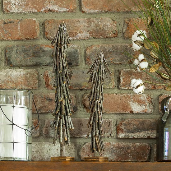 This twig Christmas tree can be made for next to nothing by using fallen branches found in your yard. A fun rustic craft to add to your holiday decor.