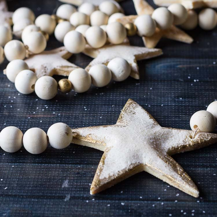 Salt dough christmas garland with wooden beads.