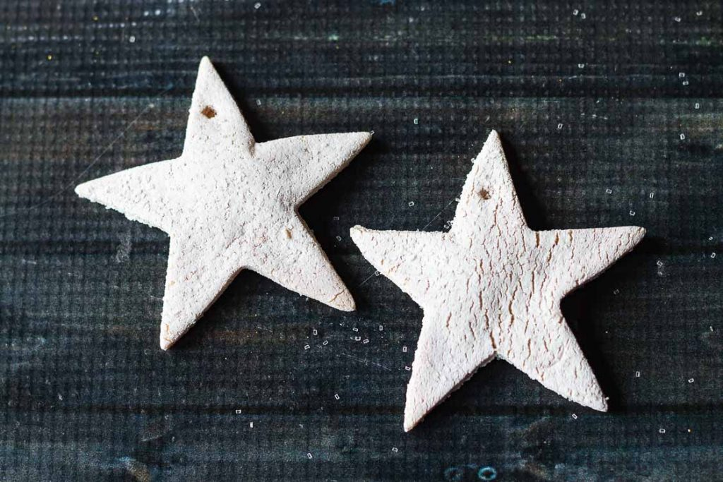 Salt dough stars with white paint and glitter