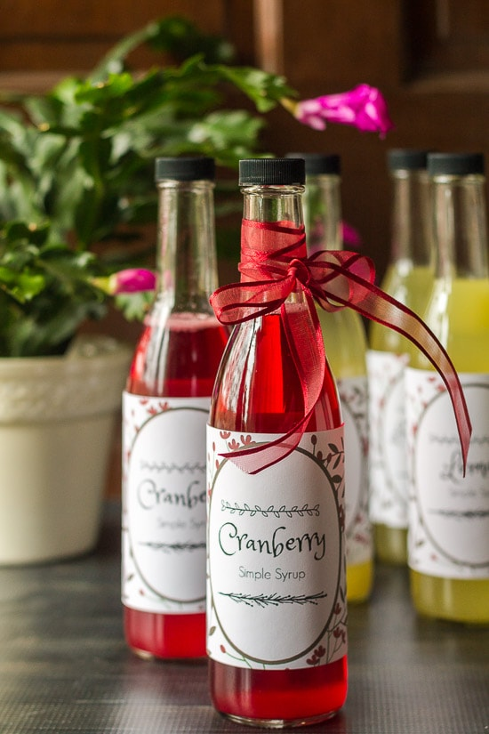 Cranberry simple syrup bottle with a red bow.