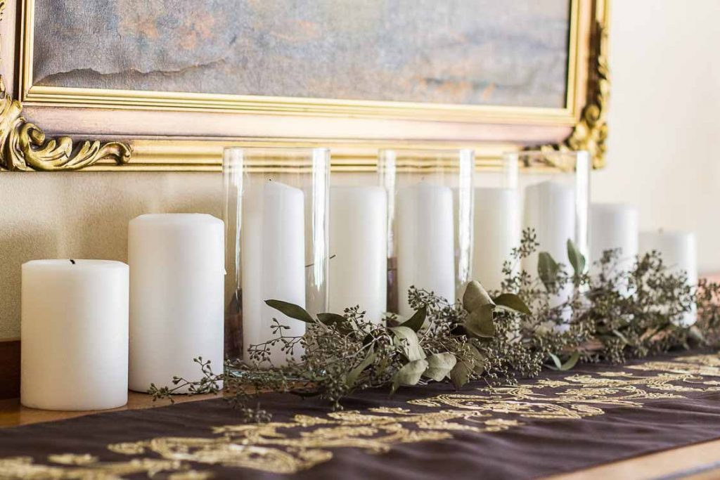 Christmas Home Tour 2017 buffet candles and greens.