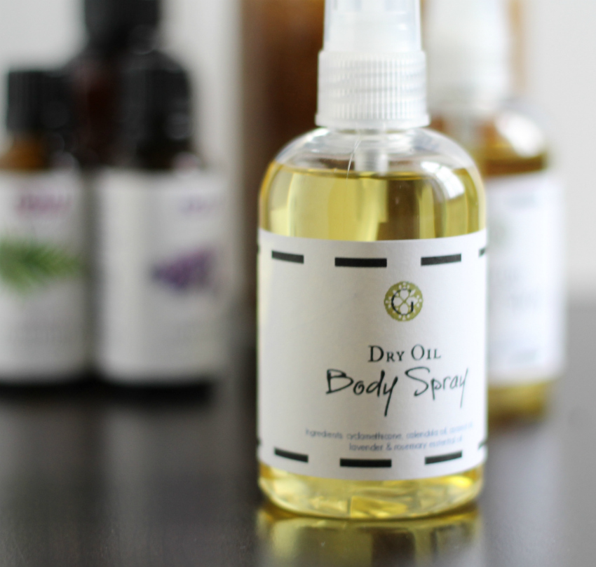 Bottle of dry oil body spray