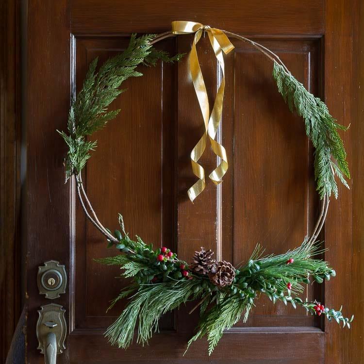 Natural Christmas wreath on front door.