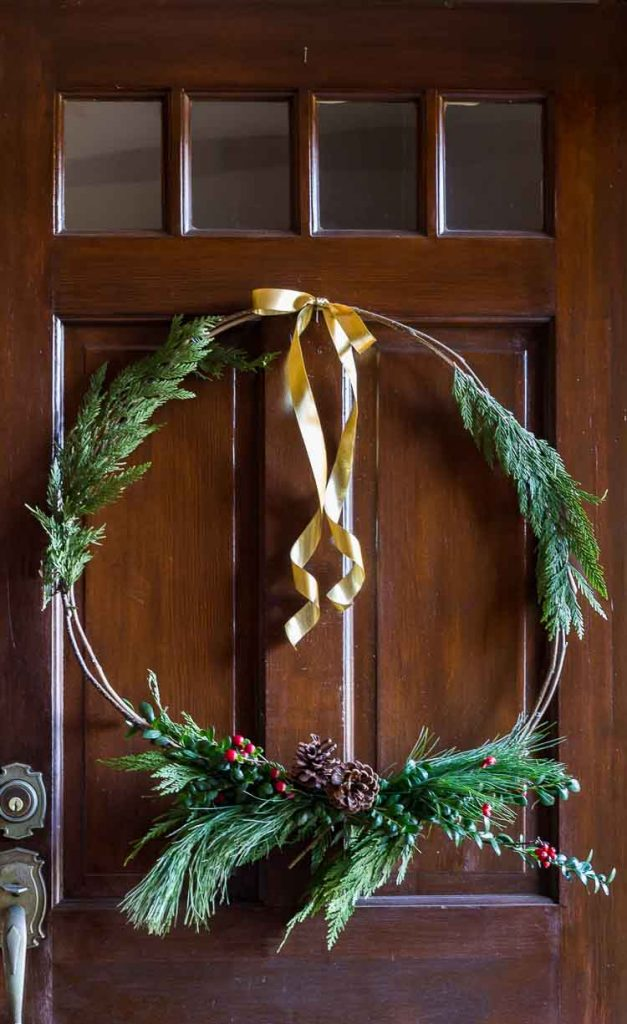 Natural Christmas wreath complete with gold ribbon.