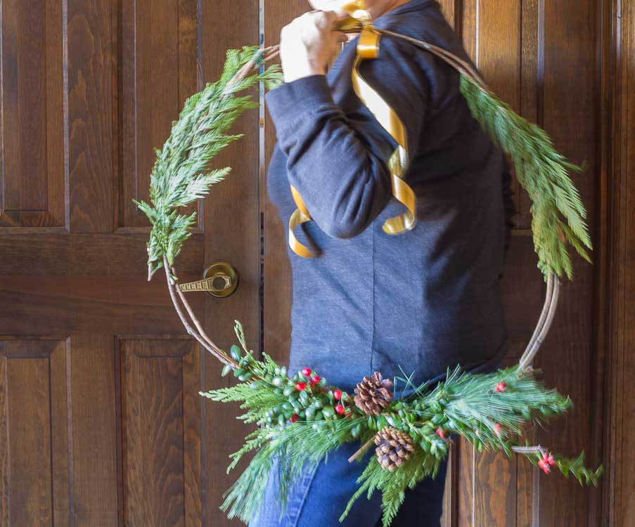 Natural Christmas wreath on shoulder.