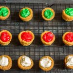 One dozen sugar cookie cups on cooling rack.