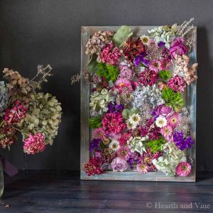 Framed dried flowers with canvas frame and wire.
