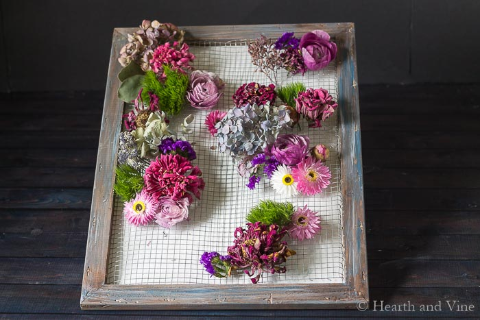 Framed dried flowers partially completed.