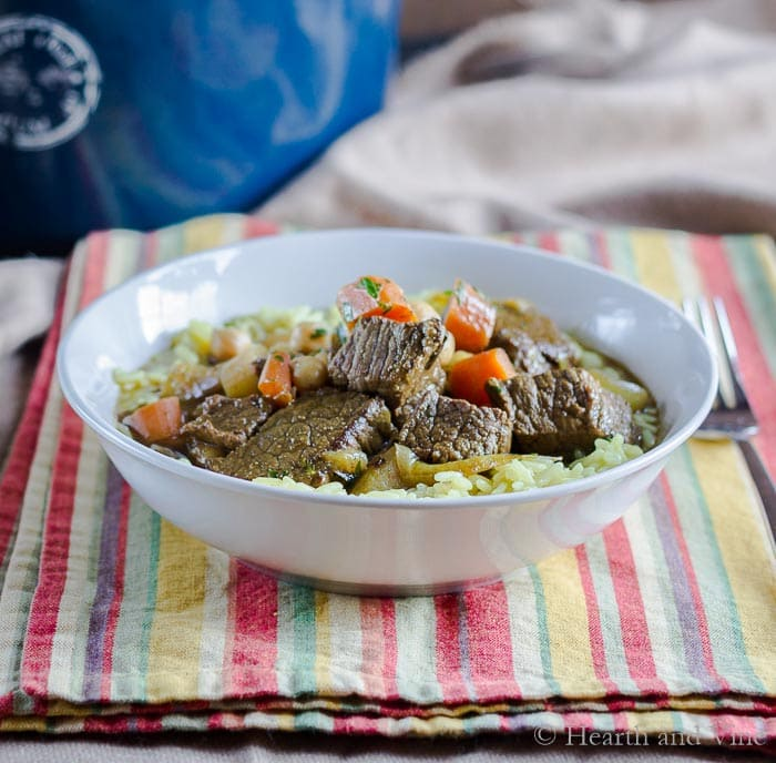 Bowl of Moroccan beef stew over rice.