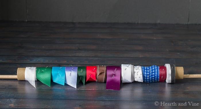 Ribbons on cardboard tube.