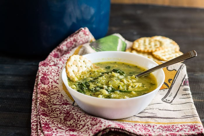 Bowl of roasted cauliflower garlic and spinach soup.