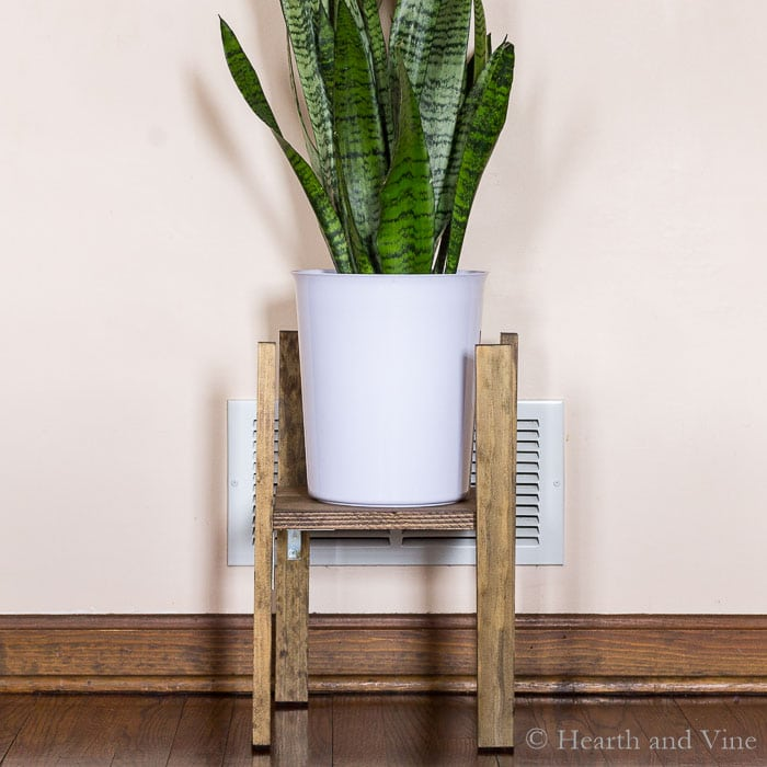 Modern plant stand with potted plant