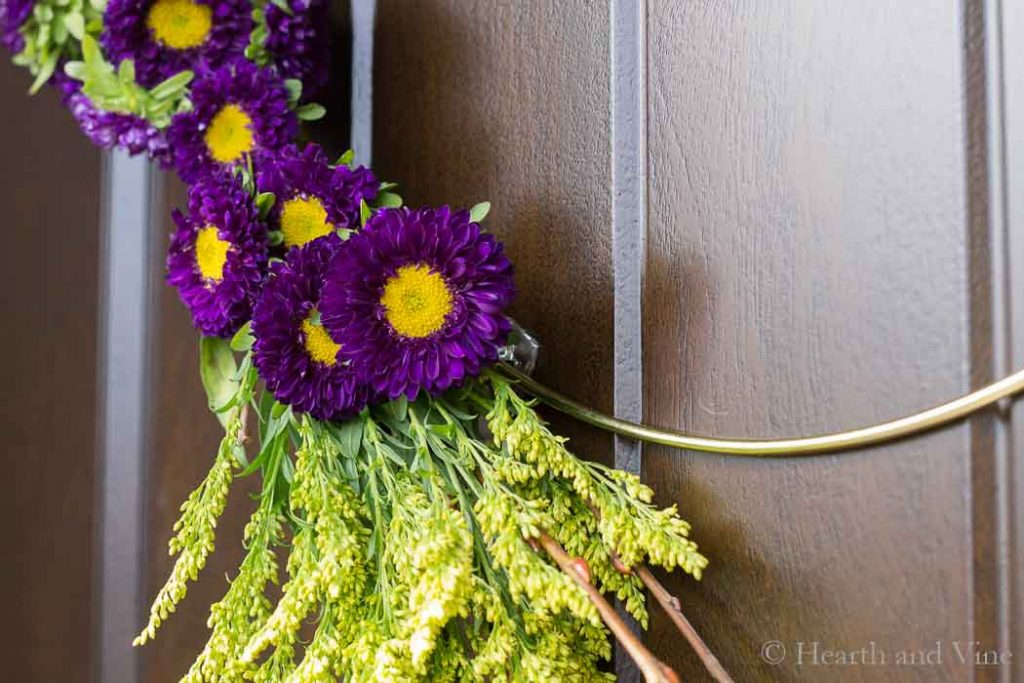 Modern spring wreath held into place with command hook.