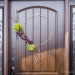 Modern spring wreath on front door.