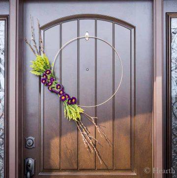Modern spring wreath on front door.