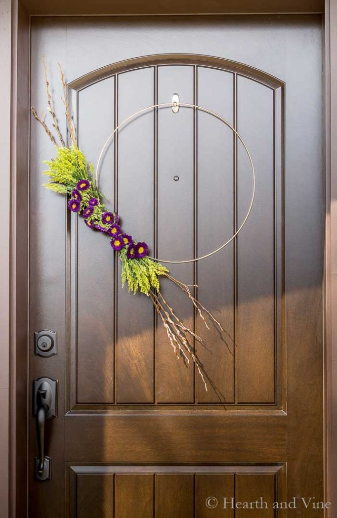Entry door with modern spring wreath