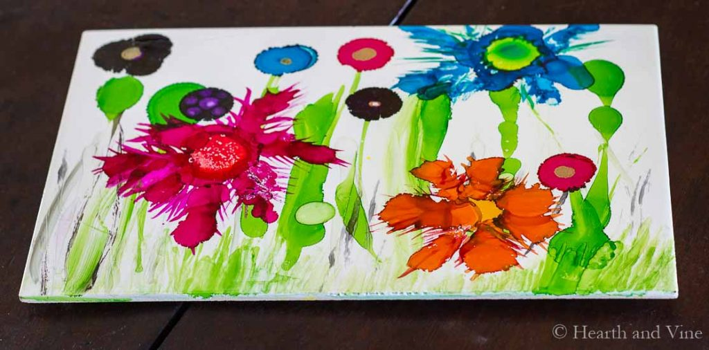 Alcohol ink trivet with big and small flowers