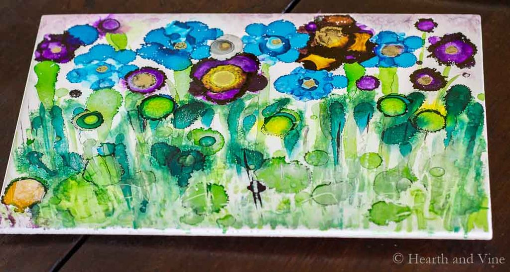 Alcohol ink trivet with field of purple and blue flowers