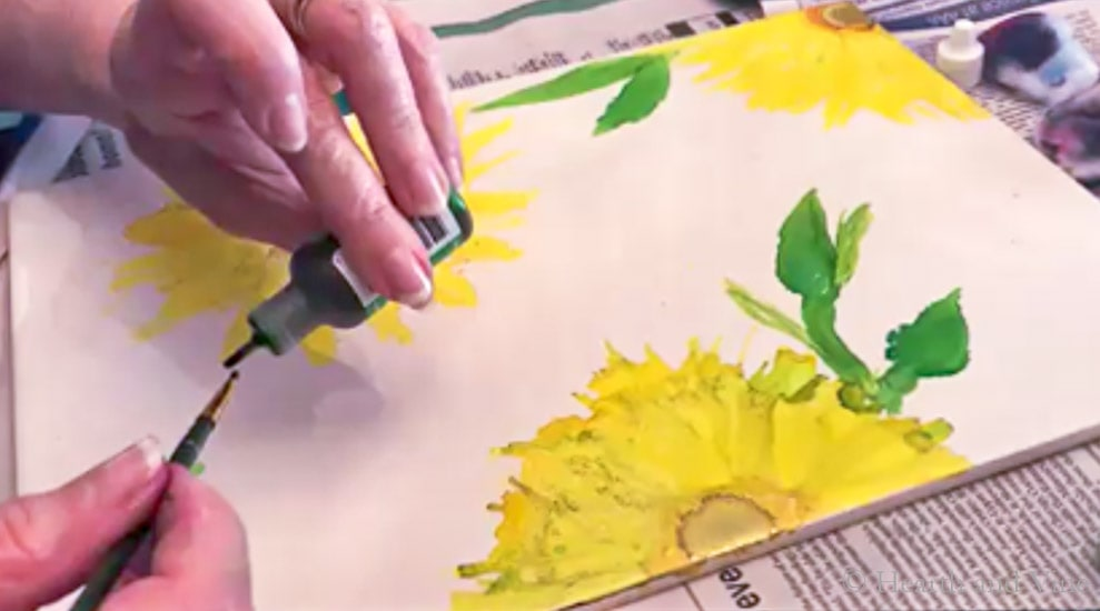 Using a paint brush with alcohol inks.