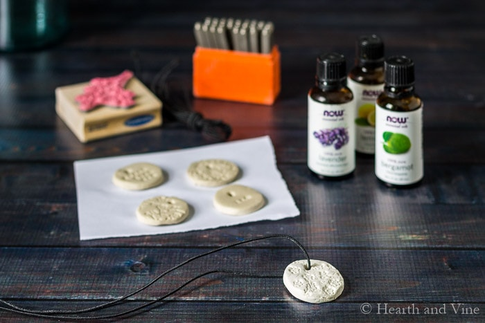 Stamping clay for essential oil diffuser necklace.