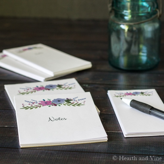 custom DIY notepads on table with pen
