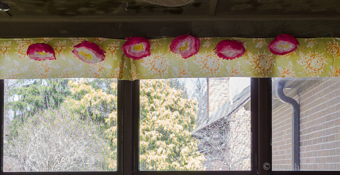 Paper peony garland on porch