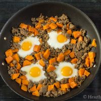 Sweet potato sausage egg fry up in pan