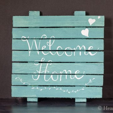 wooden sign with welcome home statement