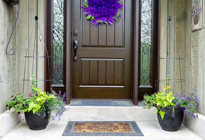 Flower pot trellis planters flanking front door.