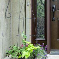 Flower pot trellis flanking door.