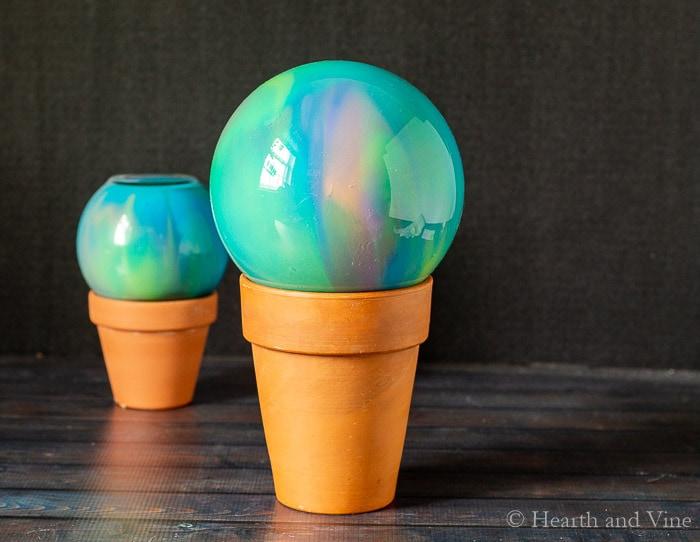 Wet gazing balls on pots