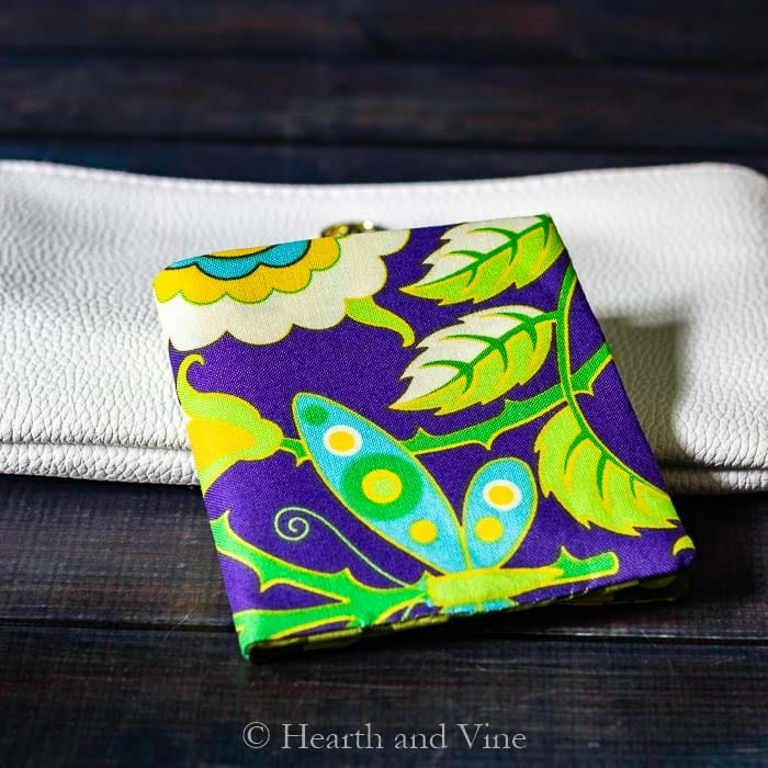 Mini fabric wallet on clutch