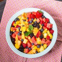 Fruit salad with ginger lime mint dressing