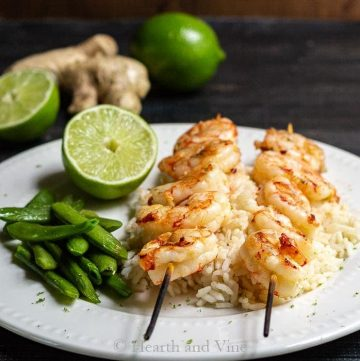 Plate of ginger lime shrimp on rice with snap peas
