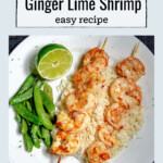 Skewered grilled shrimp on rice with a lime wedge and sugar snap peas.