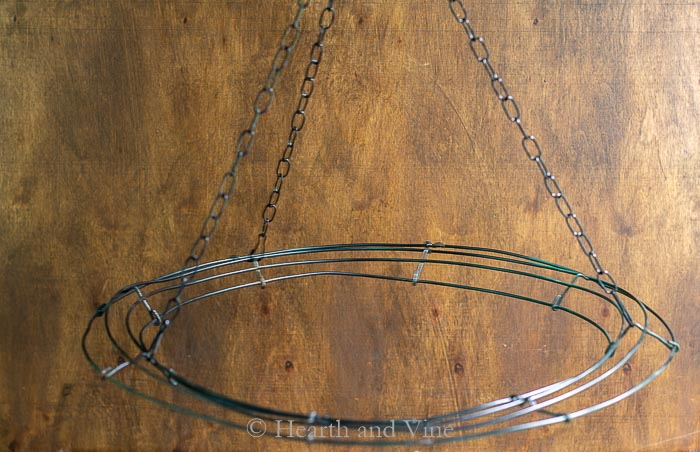 Wire wreath base hanging with chains