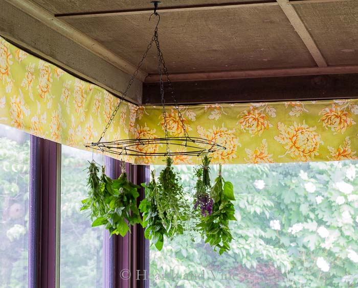 Hanging herb drying rack on porch