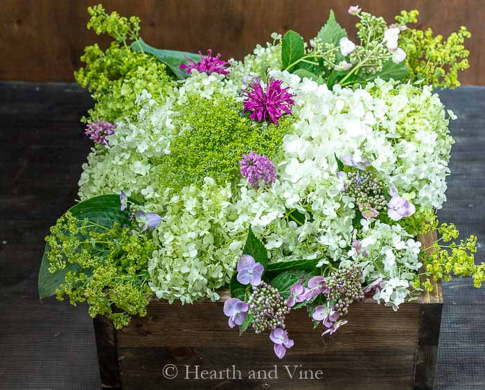 Floral centerpiece in wooden box.