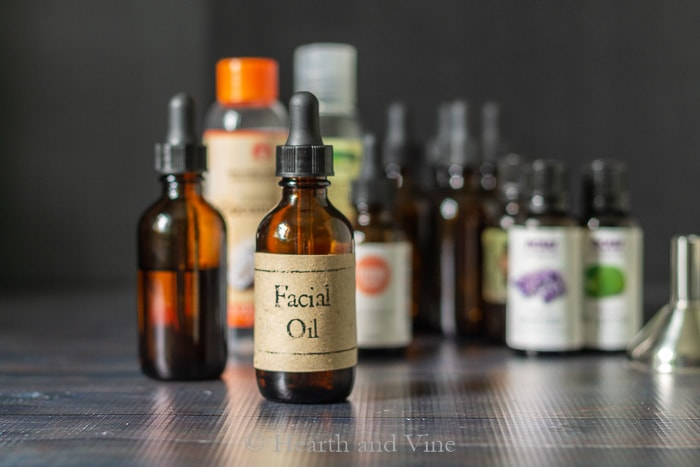 Bottle of facial oil and ingredients