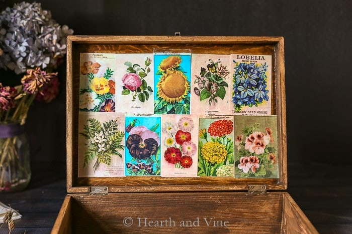 Antique flower seed box inside lid decoupaged
