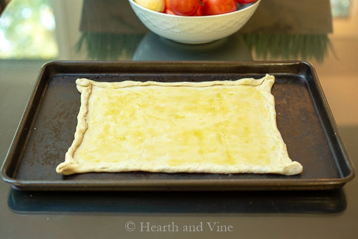 Puff pastry dough brushed with garlic oil.
