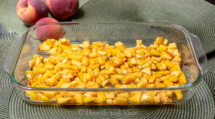 Peach and juice layer in baking pan