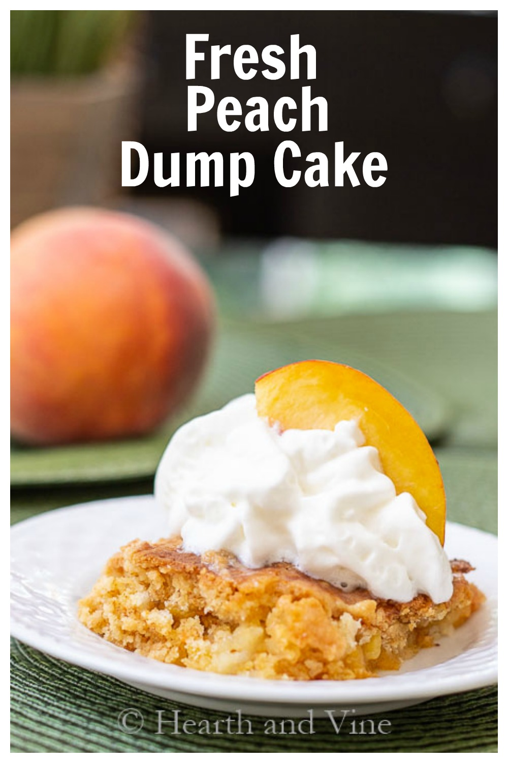 Slice of peach dump cake with whipped cream and a fresh peach slice