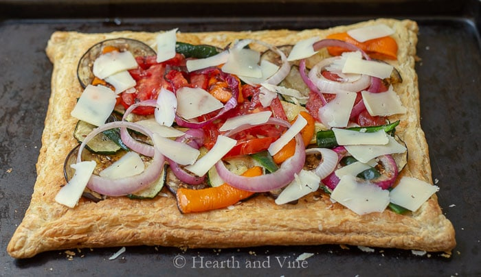 Grilled vegetables and cheese on puff pastry dough base.