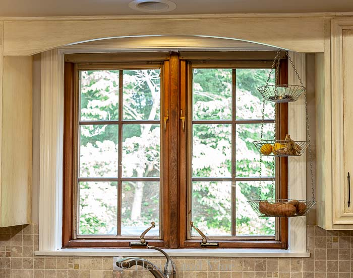 Kitchen window with dark wood dividers