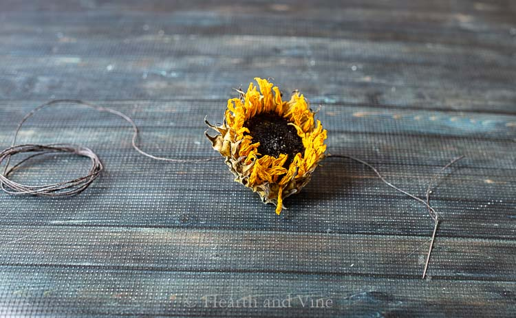 Dried flower garland thread, needle and sunflower