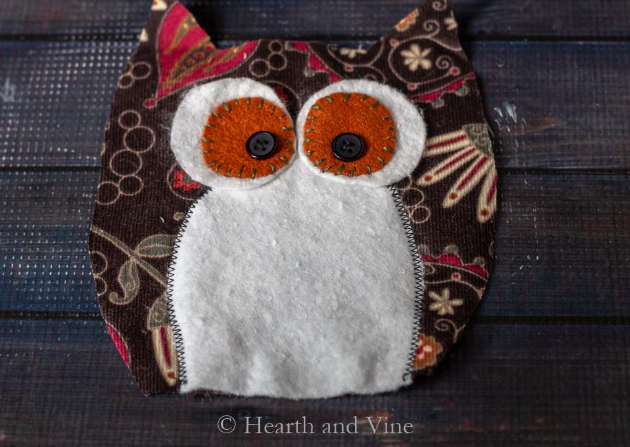 Embroidered eyes on owl