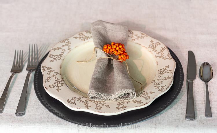 Fall table setting with pyracantha berries