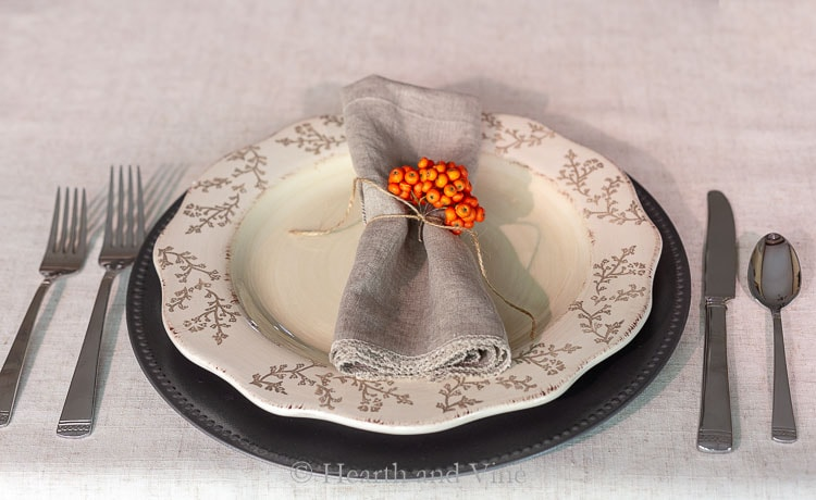 Table setting using faux galvanized charger plate