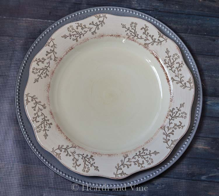 Faux galvanized charger plate under dinner plate